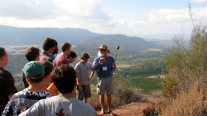 Local artist, resident, and nature lover Dennis Shives leads a group of Thacher students and faculty on a nature hike in the Sespe.