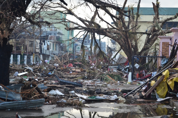 Debris lines the streets of Tacloban, Leyte island. This region was the worst affected by the typhoon, causing widespread damage and loss of life. Caritas is responding by distributing food, shelter, hygiene kits and cooking utensils. Photo Credit Eoghan Rice - Trócaire / Caritas / CC BY 2.0