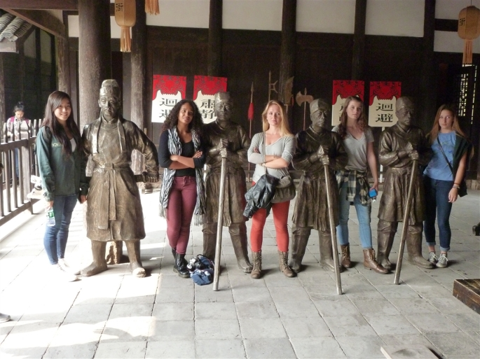 Posing with statues. The girls also had time to explore cultural treasures including the Forbidden City and The Great Wall. Photo Credit Gallia Vickery