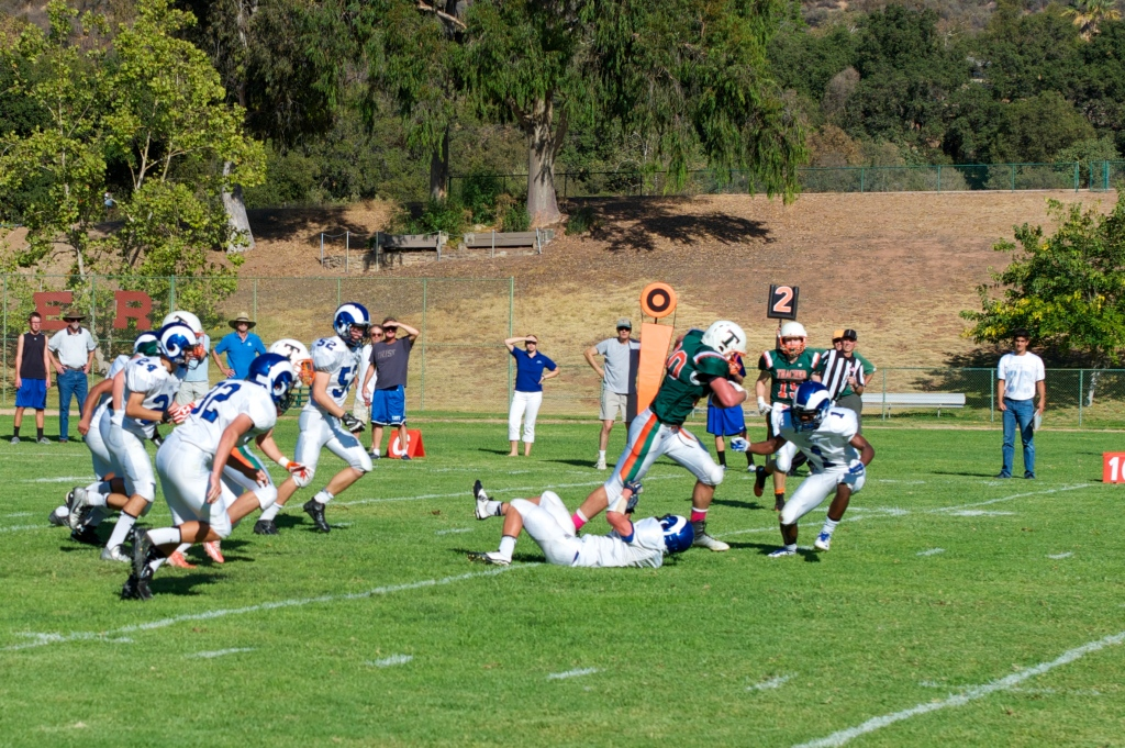 Running Back Lukas Cesena '15 breaks through the Cate defense. Photo Credit: Bynk Chanuntranont