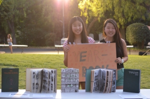Wesley Liang '15 and Ann Han '15 promote the yearbook club. Photo Credit: David Amano '15