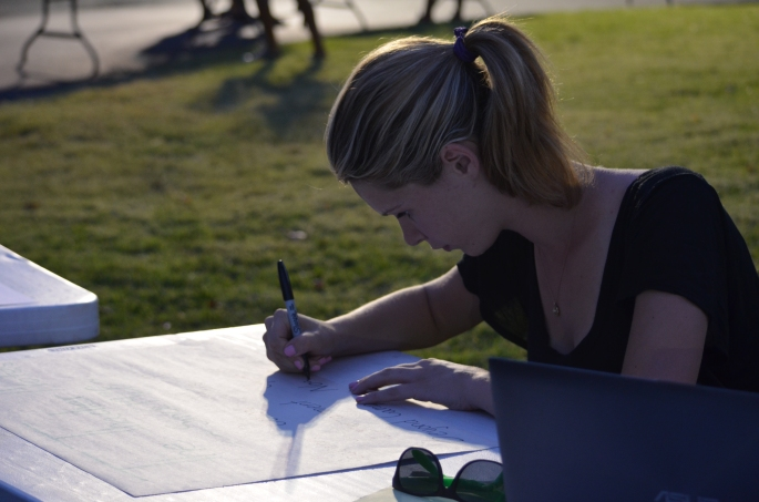 Taylor Bacon '15 prepares signs for the first annual Thacher club fair. Photo Credit: David Amano '15