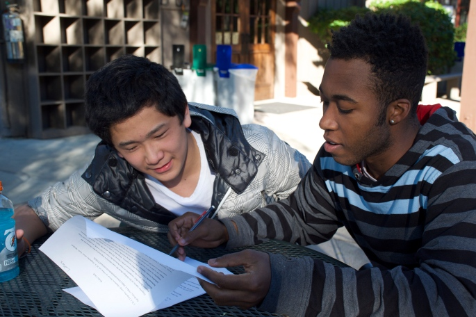 Alex Levers '15, one of the head WRC Tutors, assists Lukas Chao '17 on a portion of his most recent paper. Photo Credit: Tobi Oyinlola '17
